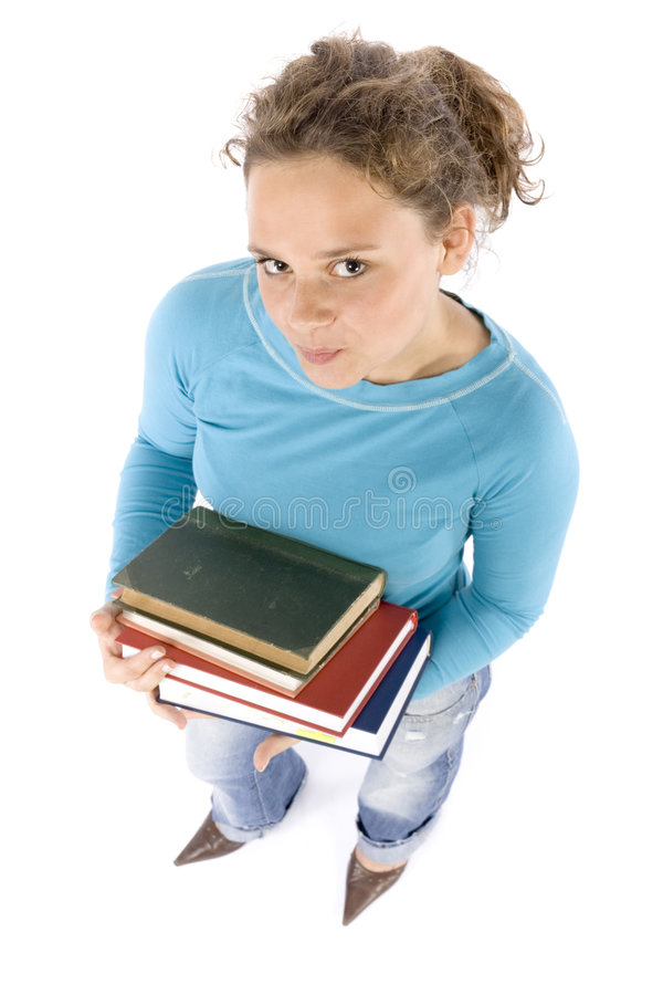 Headshot of young woman with books royalty free stock image