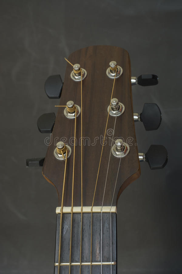 Headstock,fret bord,frets,tuners of guitar acoustic. Headstock,fret bord,frets,tuners of guitar acoustic royalty free stock photography