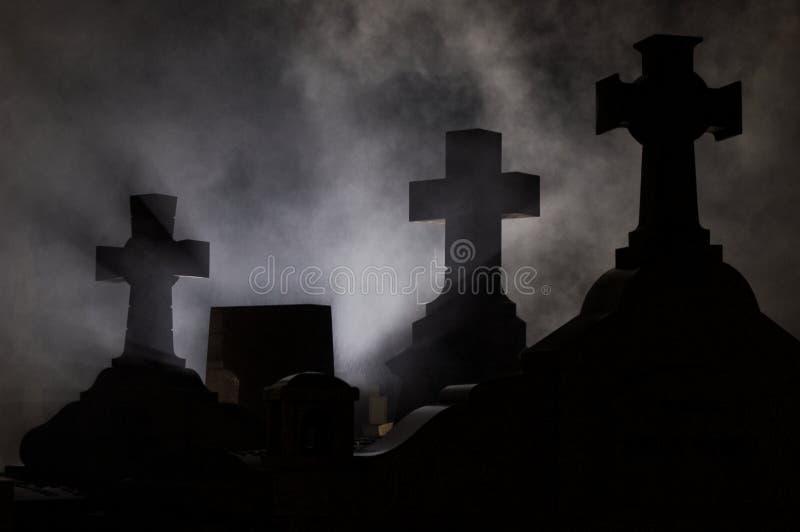 Headstone cross in Graveyard. Headstone cross in Graveyard at night royalty free stock photo