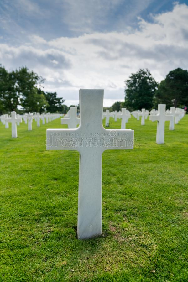 Headstone of an unmarked grave and unknown soldier at the American Cemetery at Omaha Beach. Omaha Beach, Normandy / France - 16 August 2019:  headstone of an stock image