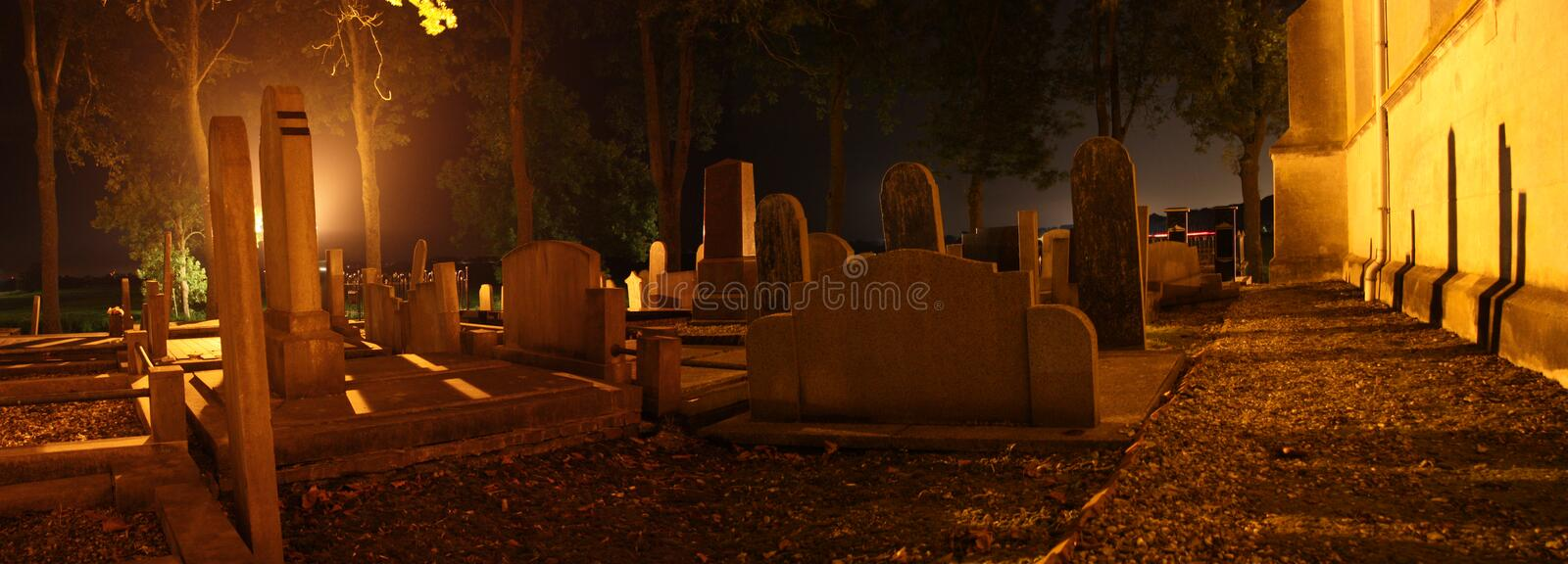 Headstones in graveyard. Headstone in Graveyard at night stock photography