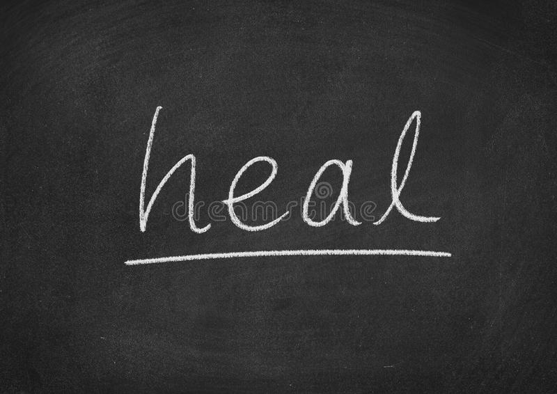 Heal. Concept word on a blackboard background royalty free stock image