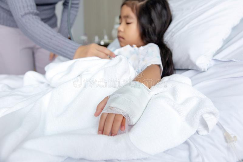 Heal Influenza A virus or H1N1 flu asian kid on hospital bed royalty free stock photography