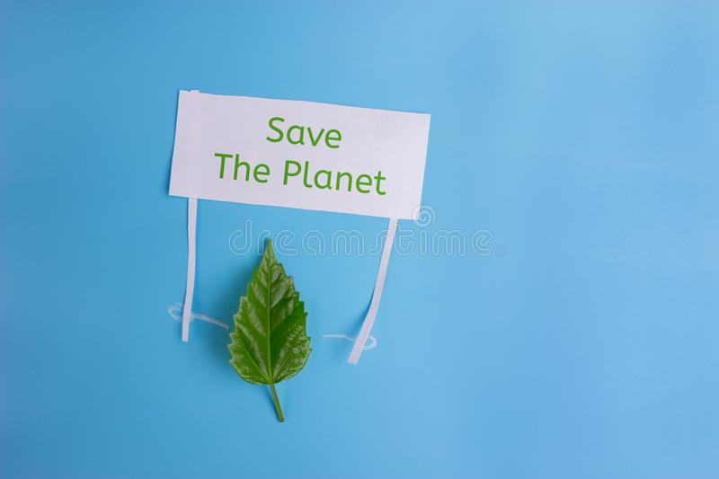 Heal the world - environment protection.leaf holding a banner royalty free stock photo