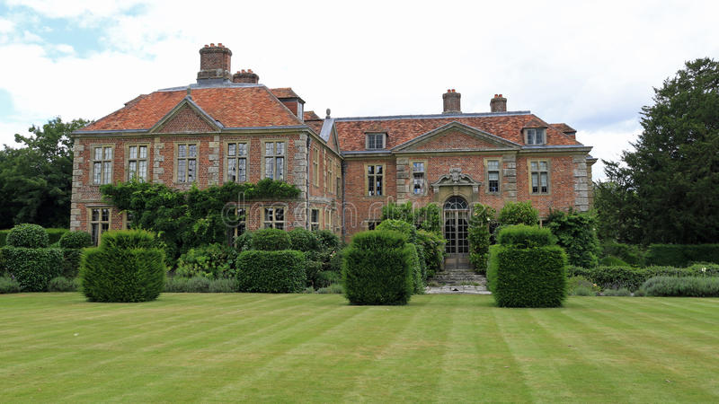 Heale House with lawn and topiary stock photography