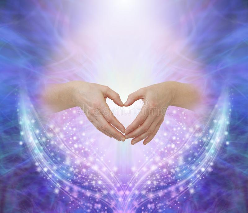 Healers hands making a humble heart shape royalty free stock image