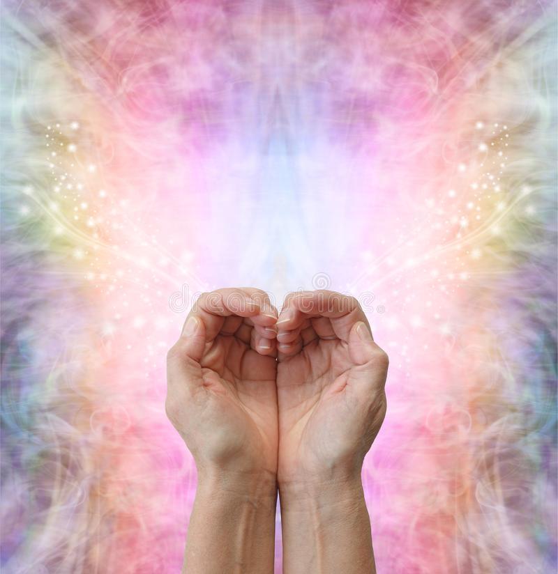 Healers hands making a humble heart shape royalty free stock photo