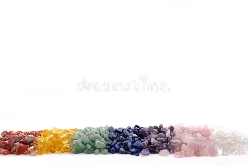 Healing Chakra Crystals Banner - Chakra colored tumbled healing stones. Crystal healing background. Healing Chakra Crystals Banner - Chakra colored healing stock images