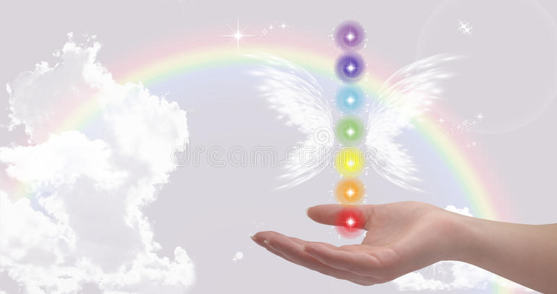 Healing hand with seven chakras royalty free stock images