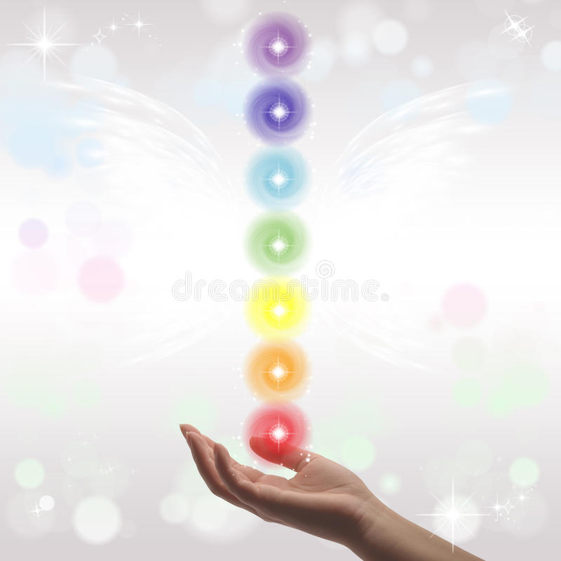 Healing Hand and seven chakras stock photo