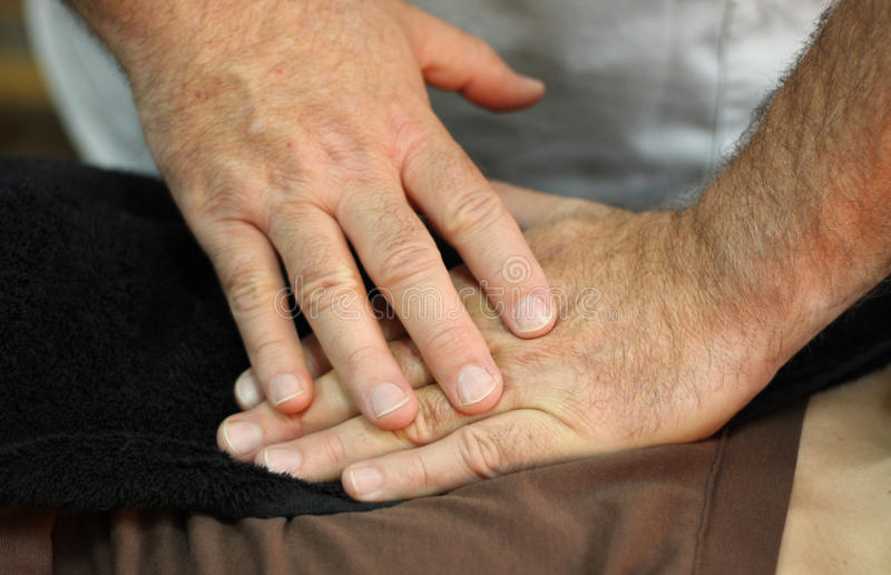 Healing hands. The healing hands of an osteopath royalty free stock photography