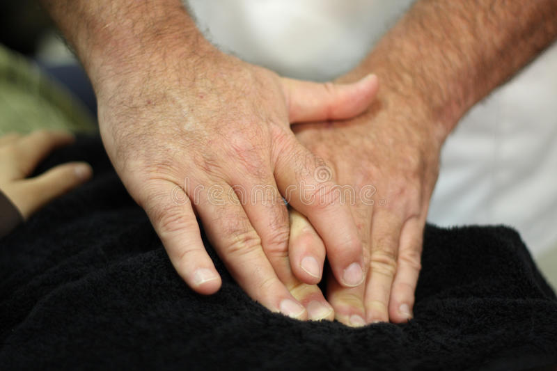 Healing hands. The healing hands of an osteopath stock image