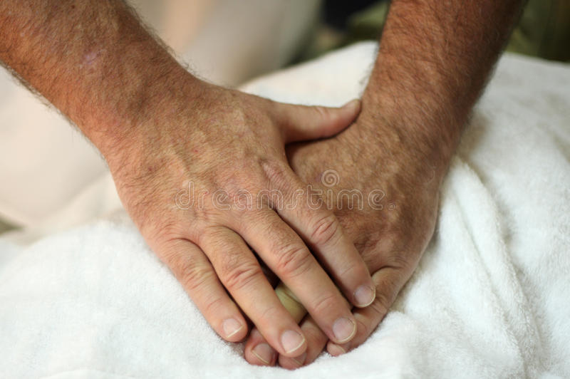 Healing hands. The healing hands of an osteopath royalty free stock image