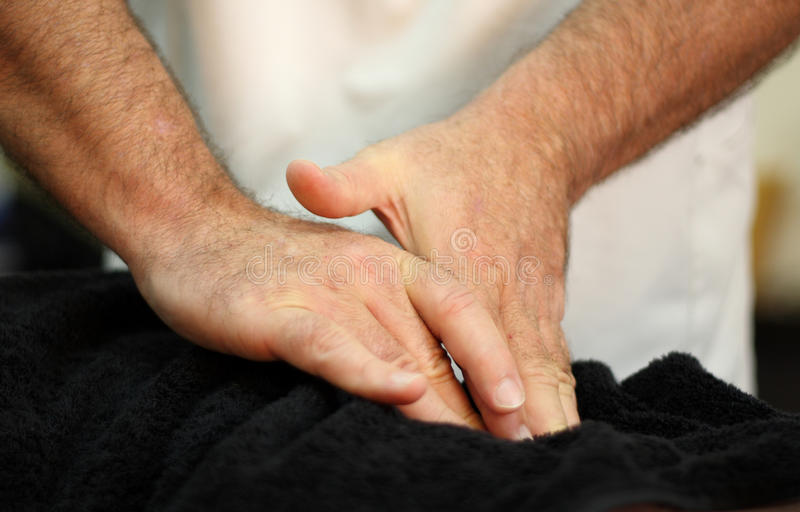 Healing hands. The healing hands of an osteopath stock photos