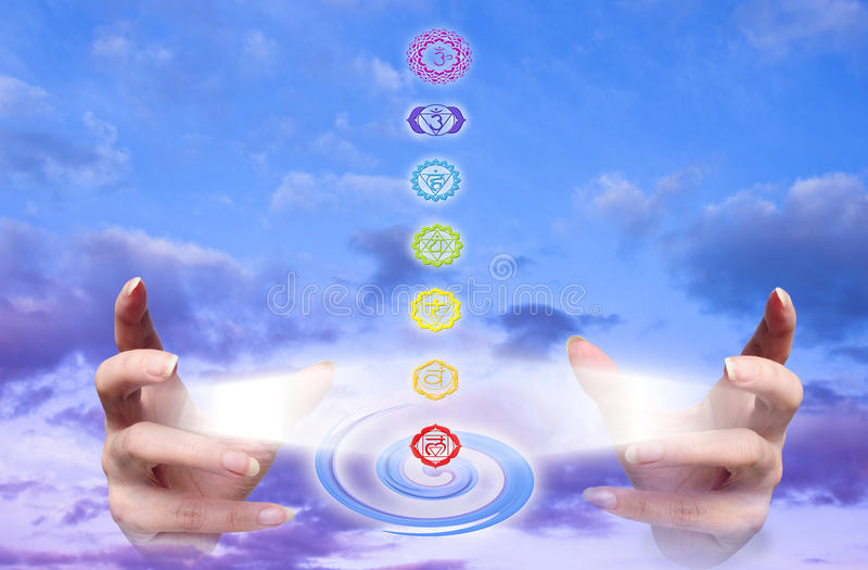Healing hands. Hands with rays of light and seven chakra like a concept of healing energy stock images