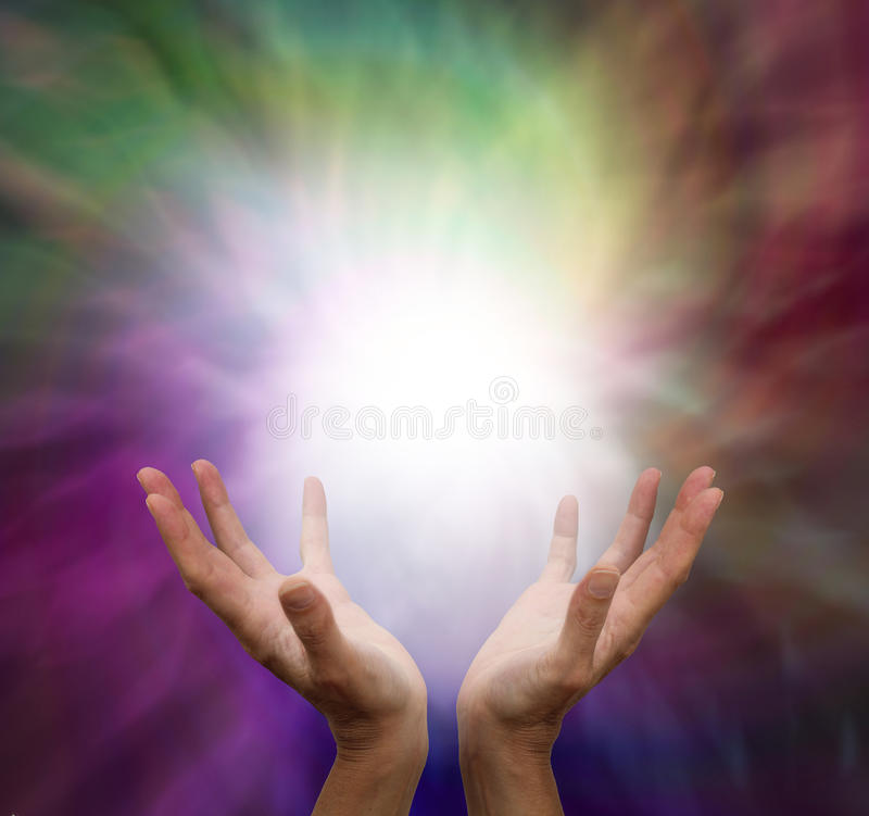 Healing hands and energy. Healer with outstretched hands sensing energy on muted color background royalty free stock image
