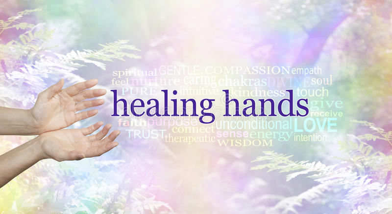 Healing Hands and Nature Word Cloud. Female hands in open giving gesture a HEALING HANDS word cloud beside on a rainbow colored soft focus woodland scene royalty free stock images
