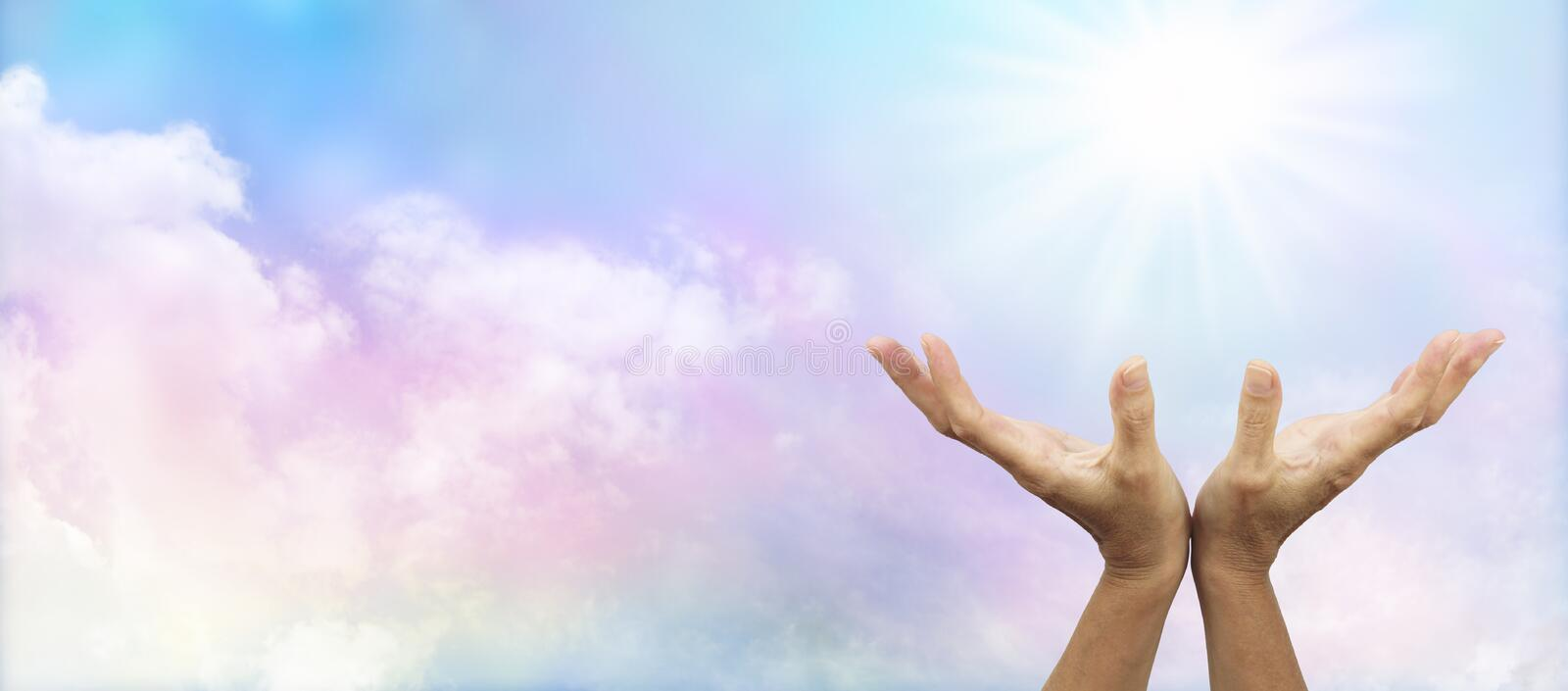 Healing Hands outstretched towards sun royalty free stock photography
