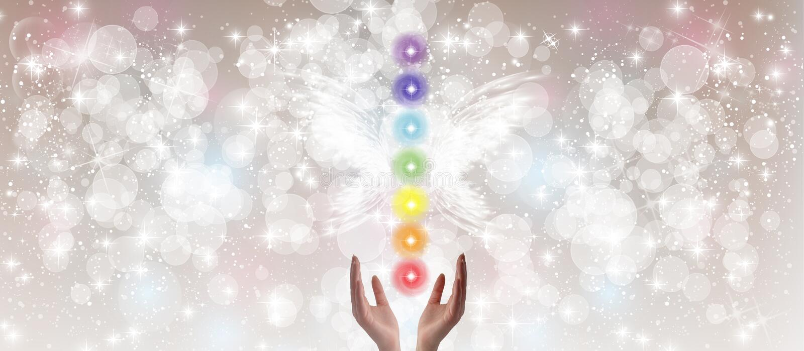 Healing Hands and seven chakras. On a sparkling pastel coloured background stock illustration