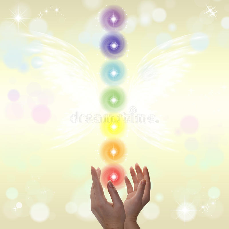 Healing Hands and seven chakras. On a sparkling pastel coloured background stock photo