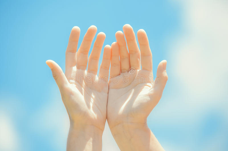 Healing hands. On the sky stock photography