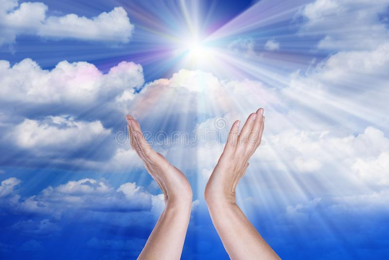 Healing hands in the sky with bright sunburst. Healing hands in the sky with bright sunburst stock photos