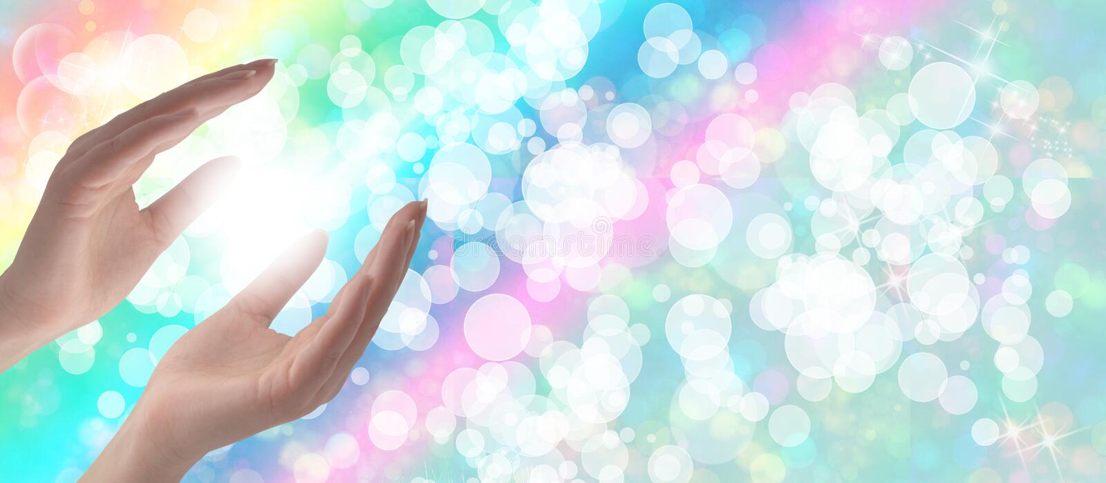Healing Hands. On a sparkling pastel coloured background royalty free stock image