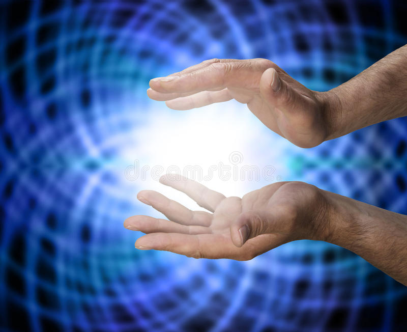 Healing Matrix. Male healers hands with a blue matrix energy background stock photos