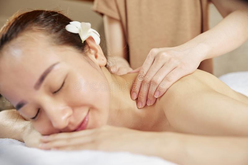 Healing neck and shoulders massage royalty free stock images