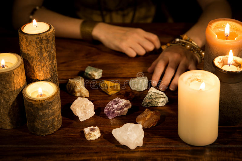 Healing stones, candles and fortune teller hands, concept life c. A lot of healing stones, candles and fortune teller hands, concept life coaching royalty free stock photos