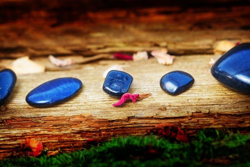 Healing stones on old wood stock photo