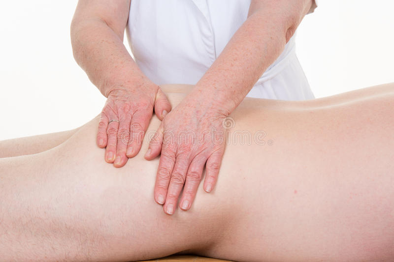 Healing touch of a ostheopath hands on man's body. Healing touch of a ostheopath hands on a body of a mature man stock images