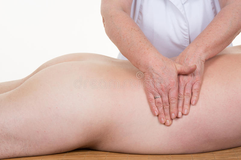 Healing touch of a physiotherapist hands on a body. Of a man royalty free stock image