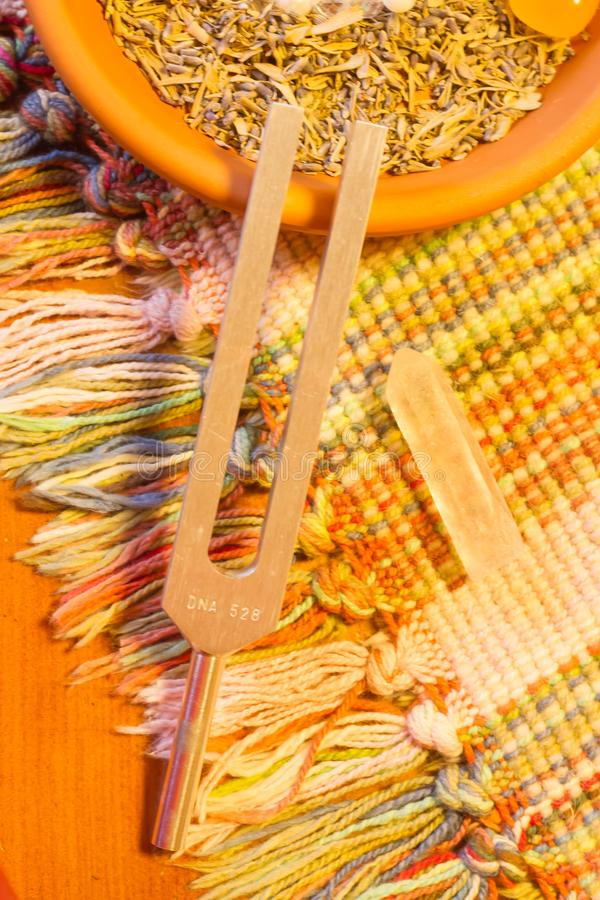 Healing tuning fork and crystal stone on table .  royalty free stock images