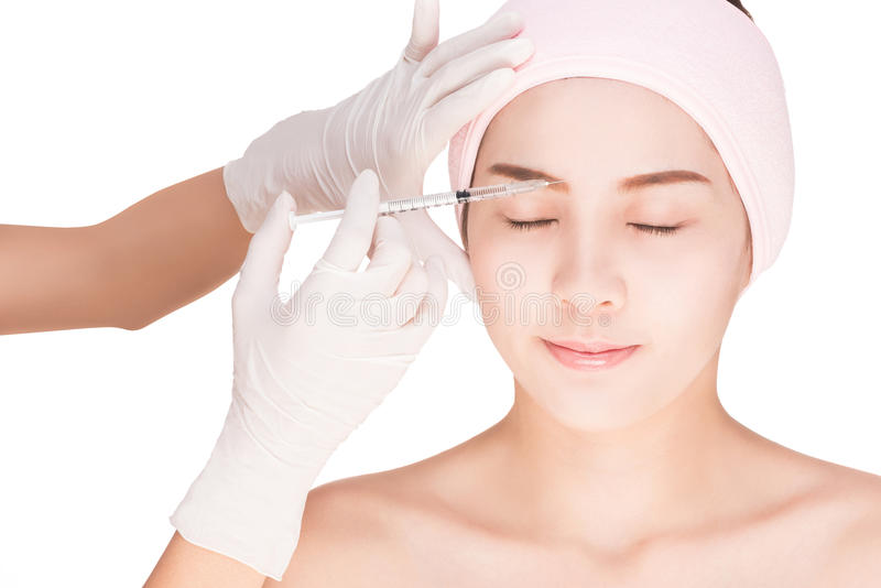 Health and beauty concept - Beautiful woman gets an injection in her face stock photography