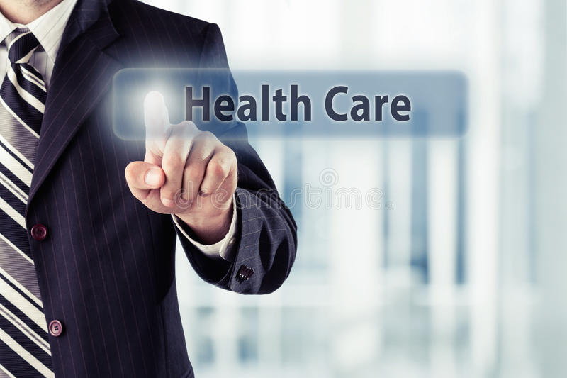 Health Care. Businessman pressing virtual Health Care button. Health Care concept, toned photo royalty free stock images