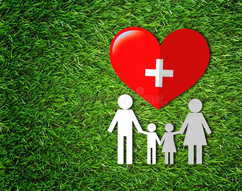 Health Care Concept Background. Health care and insurance concept, family white paper and heart on green grass background stock photos