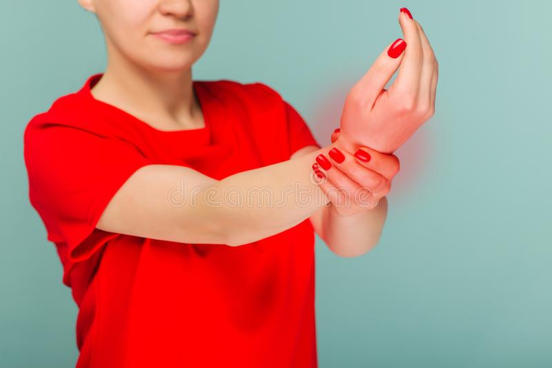 Health care concept. Close up woman holding her wrist . Pain in the joints of the hands. Carpal tunnel syndrome royalty free stock image