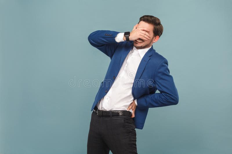 Health care. Man closed eyes and have discomfort in spine stock image