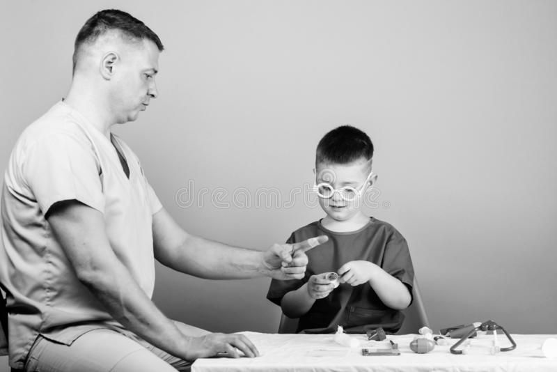 Health care. Medical examination. Boy cute child and his father doctor. Hospital worker. First aid. Medical help. Trauma. And injurie. Medicine concept. Kid stock photos