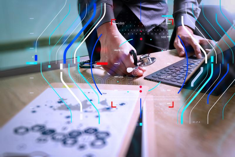 Medical technology concept. Doctor hand working with modern digital tablet dock screen computer with medical chart interface, Sun. Health care and medical royalty free stock images