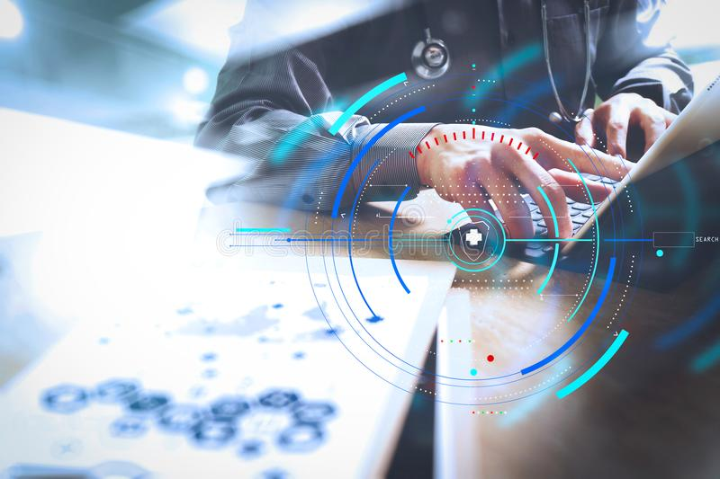 Medical technology concept. Doctor hand working with modern digital tablet dock screen computer with medical chart interface, Sun. Health care and medical royalty free stock image