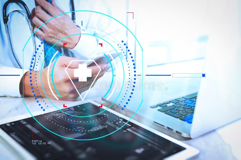 Medical technology concept. Doctor hand working with modern digital tablet and laptop computer with medical chart interface, Sun. Health care and medical stock photos