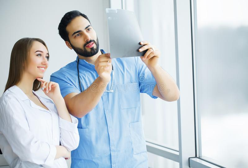 Health Care. Medical Team Examining X-ray Report in Corridor. Me. Dical Concept royalty free stock images
