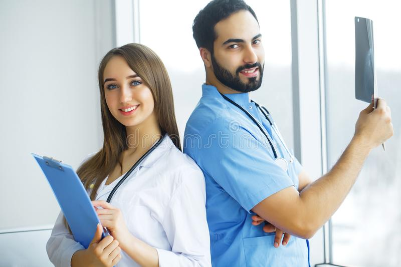 Health Care. Medical Team Examining X-ray Report in Corridor. Me. Dical Concept royalty free stock photo