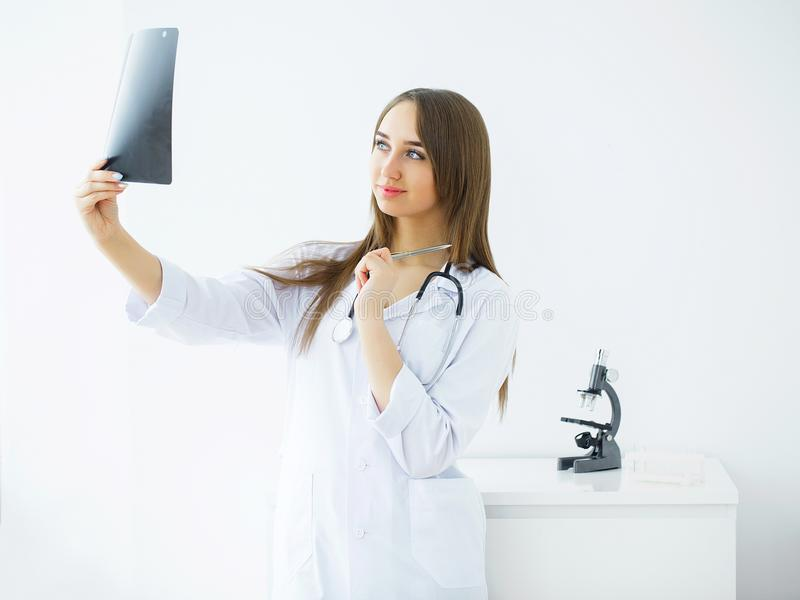 Health Care. Portrait of Female Nurse Examining X-ray Report. Me. Dical Concept royalty free stock photo
