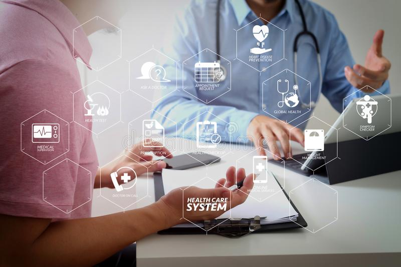 Medical doctor using mobile phone and consulting businessman pat. Health care system diagram with health check and symptom on VR dashboard.Medical doctor using stock image
