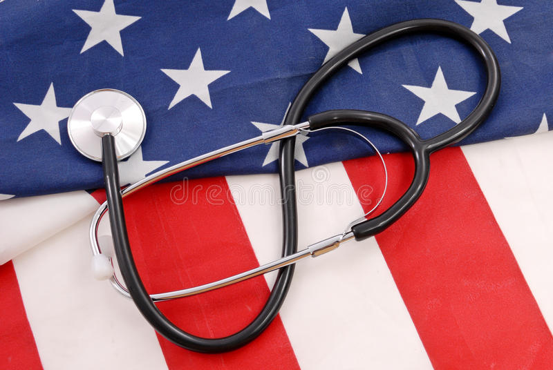 Health Care for the USA. American Flag With Doctors Stethoscope royalty free stock photos