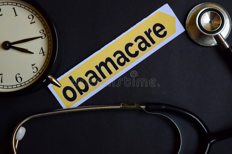 Health Check on the print paper with Healthcare Concept Inspiration. alarm clock, Black stethoscope.Obamacare on the print paper w royalty free stock photos