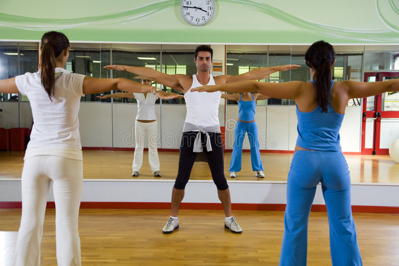 Health club. Man and women doing stretching and aerobics stock photo